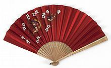 RED SATIN AND WOOD FOLDING FAN Hunt Allen-style red satin leaf painted with three bluebirds amongst apple blossoms. Blond wood stick...