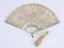 SILK, LACE, AND MOTHER-OF-PEARL FOLDING FAN Central vignette delicately hand painted with a lady and a dove flanked by flowers and b...