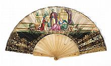 PAPER AND HORN (?) FOLDING FAN Double-sided paper leaf illustrating a harem scene on front side with gold foil arabesque borders; a...