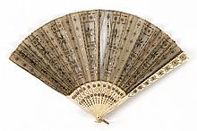 NET AND BONE FOLDING FAN Gold and silver sequins and spangles extensively scattered over the leaf of netting. Etched bone sticks and...