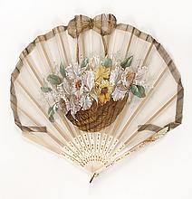 NET AND IVORY FONTAGE FAN Leaf painted with a basket of daffodils and outlined with a ribbon shaped to a bow at the top. Wavy shaped...
