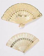 TWO CHILD'S CELLULOID BRISÉ FOLDING FANS One simulating carved ivory, length 4.5