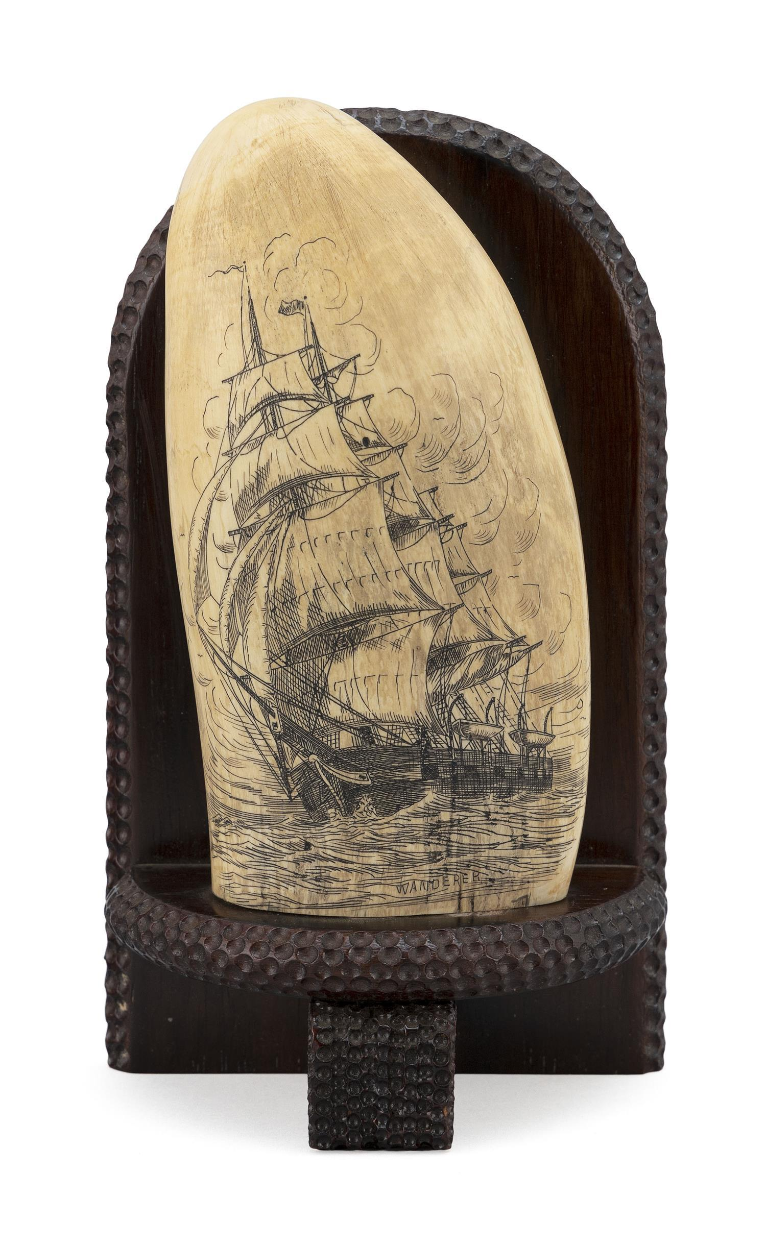 * ENGRAVED WHALE'S TOOTH BY WILLIAM PERRY Depicts a bow-view portrait of the whaleship Wanderer, with the ship's name incorporated i.