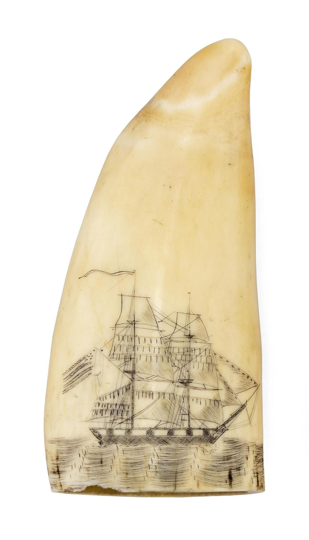 SCRIMSHAW WHALE'S TOOTH Depicts a two-masted brig at sea, flying a large American flag off the stern and a long pennant from the mas..