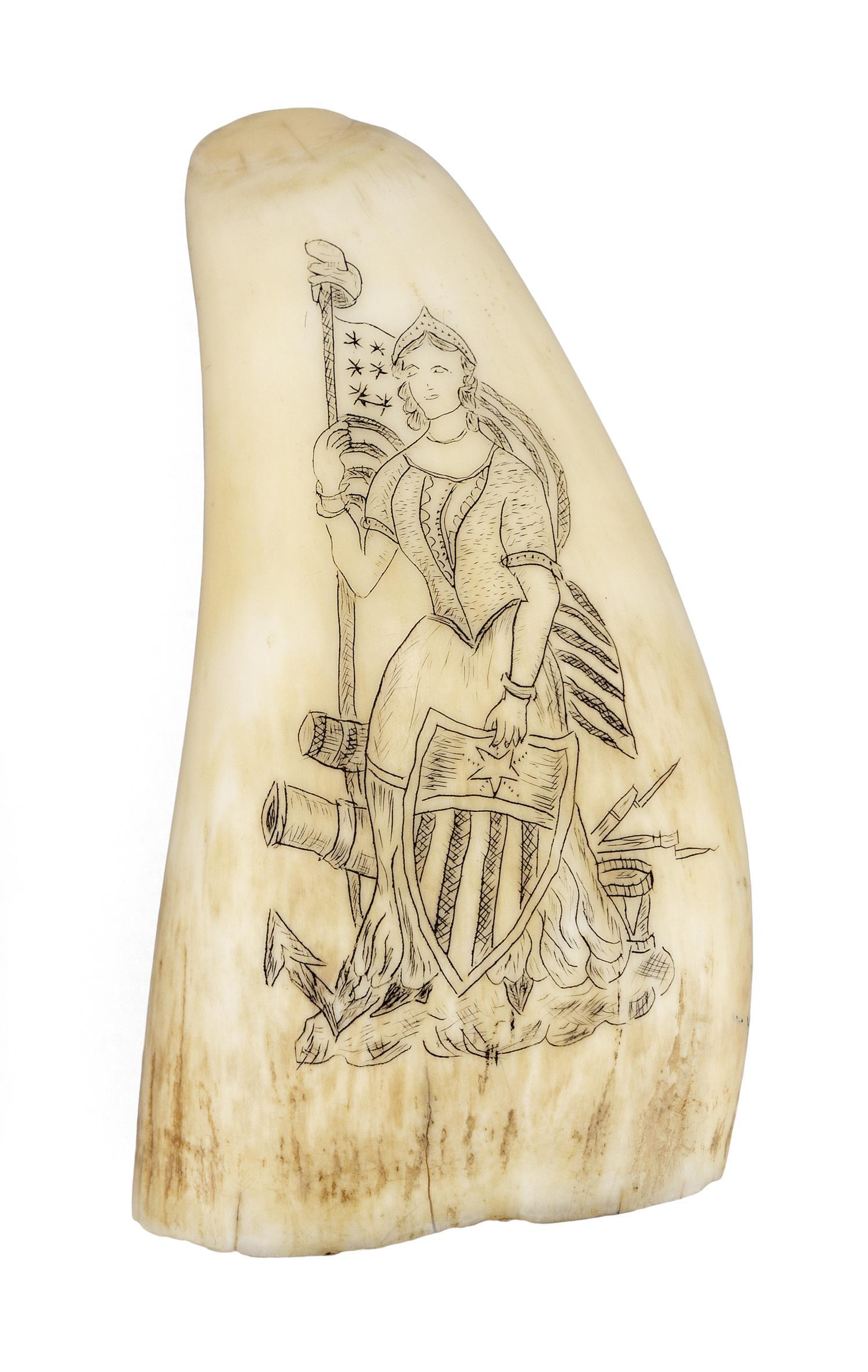 * ENGRAVED WHALE'S TOOTH Obverse depicts Lady Liberty holding a Liberty shield and an American flag on a pole topped with a Phrygian..