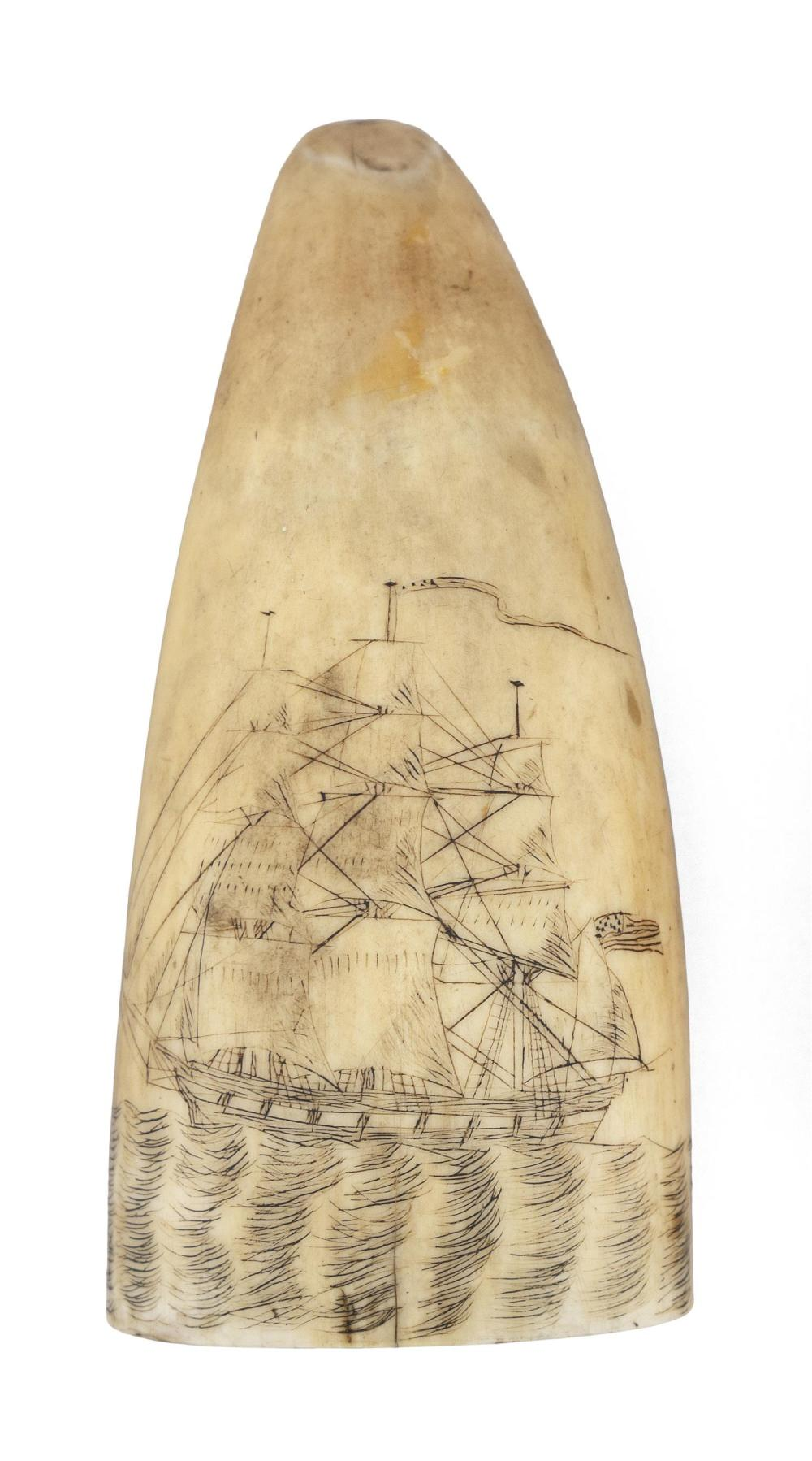 POLYCHROME SCRIMSHAW WHALE'S TOOTH Depicts a ship at sea flying a long pennant from the central mast and an American flag off the st..