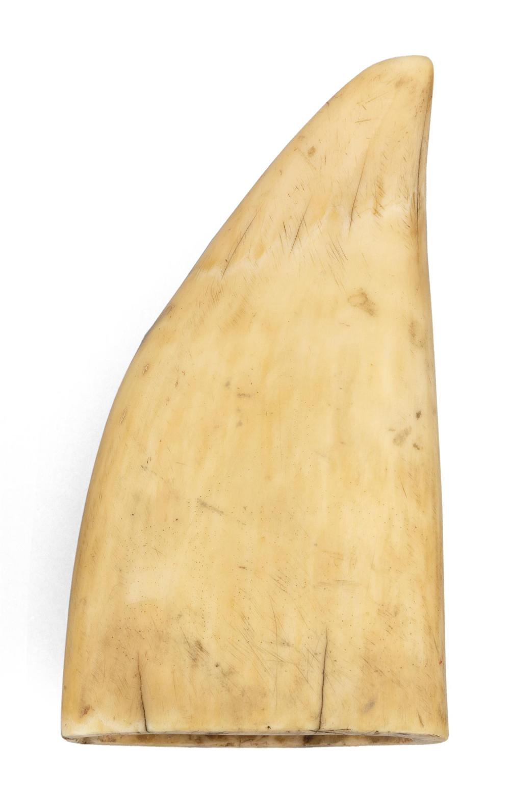 SCRIMSHAW WHALE'S TOOTH DEPICTING A CHURCH Believed to be a scene in Portsmouth, New Hampshire. Some pinpoint elements. Length 4.5
