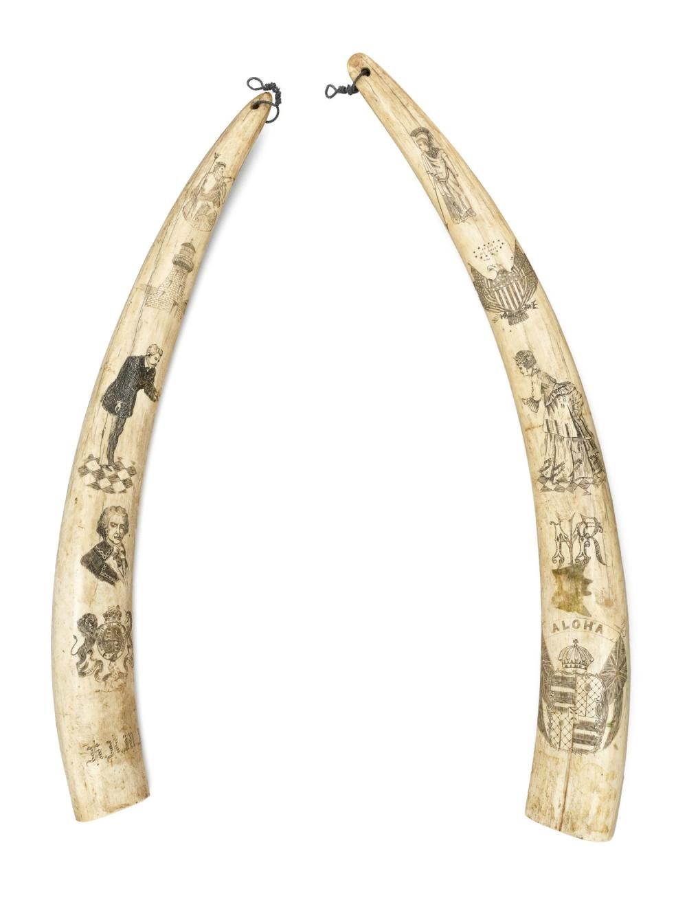 PAIR OF SCRIMSHAW WALRUS TUSKS WITH HAWAIIAN, AMERICAN AND BRITISH MOTIFS An intriguing compilation of images, including Poseidon, a...