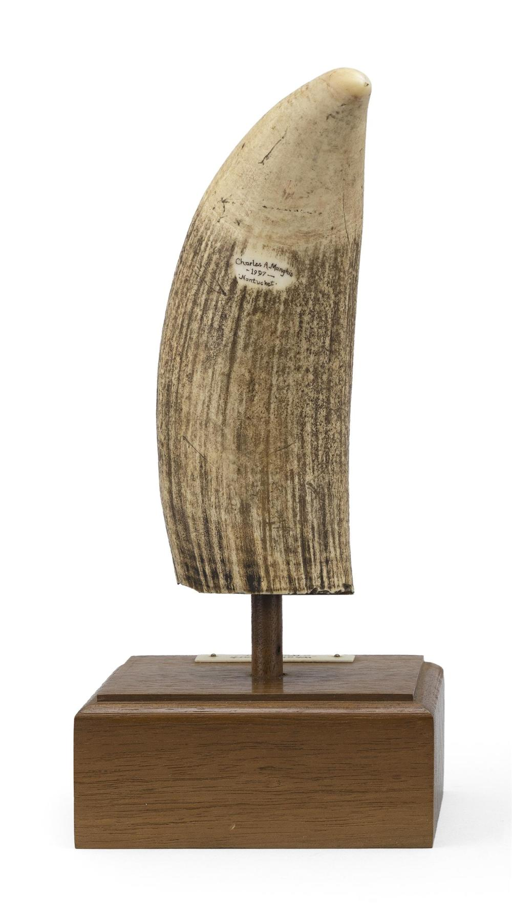 * POLYCHROME ENGRAVED WHALE'S TOOTH BY CHARLES A. MANGHIS OF NANTUCKET Oval reserve depicts a stern-view portrait of the whaling bar..