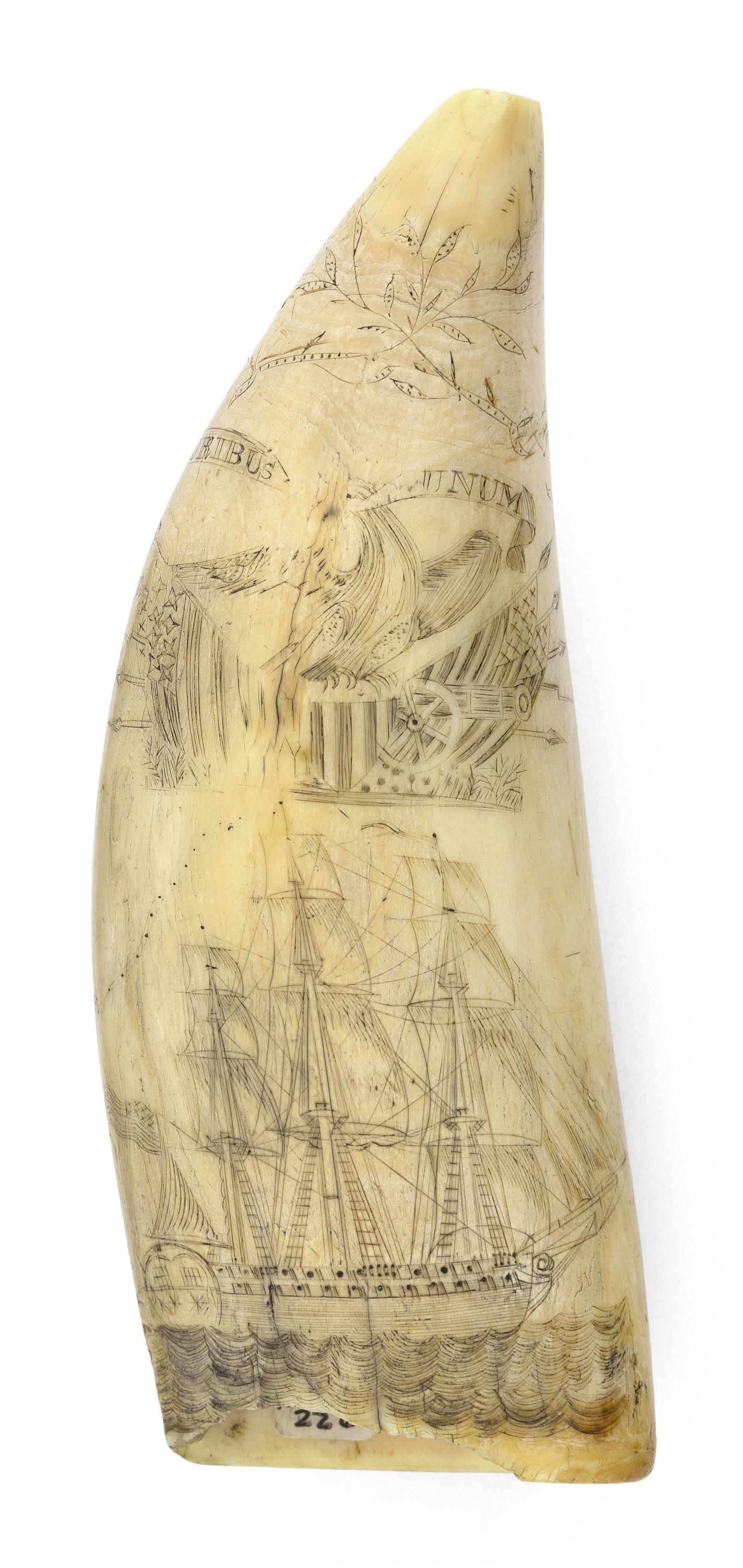 SCRIMSHAW WHALE'S TOOTH SIGNED BY WILLIAM SIZER AND DATED 1834 Collection of mostly patriotic motifs covers nearly the entire surfac..