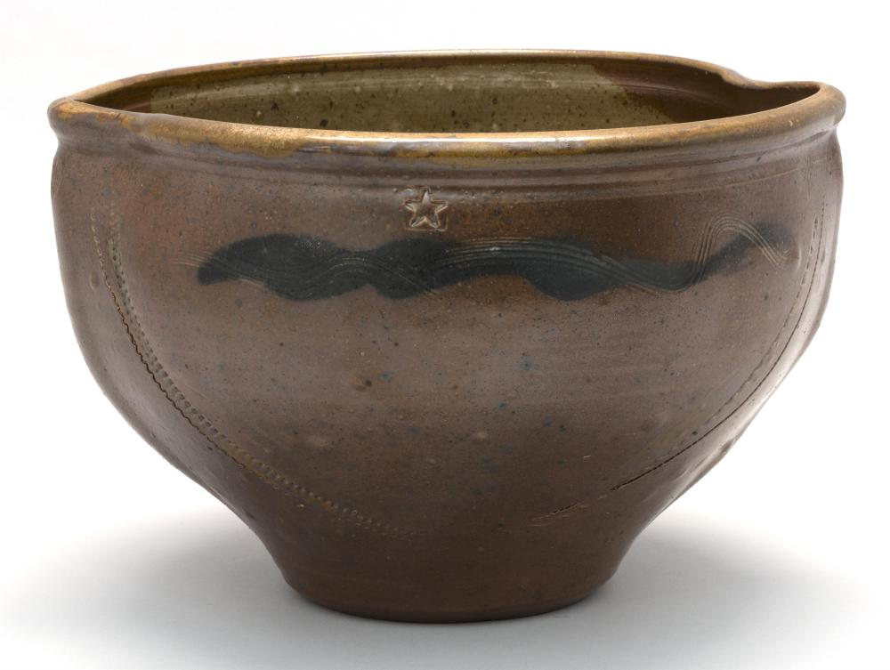 MODERN ART POTTERY BOWL With pinched rim. Incised shell, star, and seaweed decoration on a brown-glazed ground. Signed illegibly on...