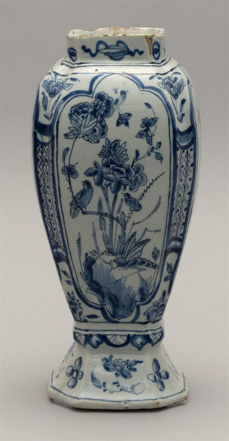 DELFT BLUE AND WHITE POTTERY VASE In rectangular baluster form with bird and flower decoration. Height 7.75