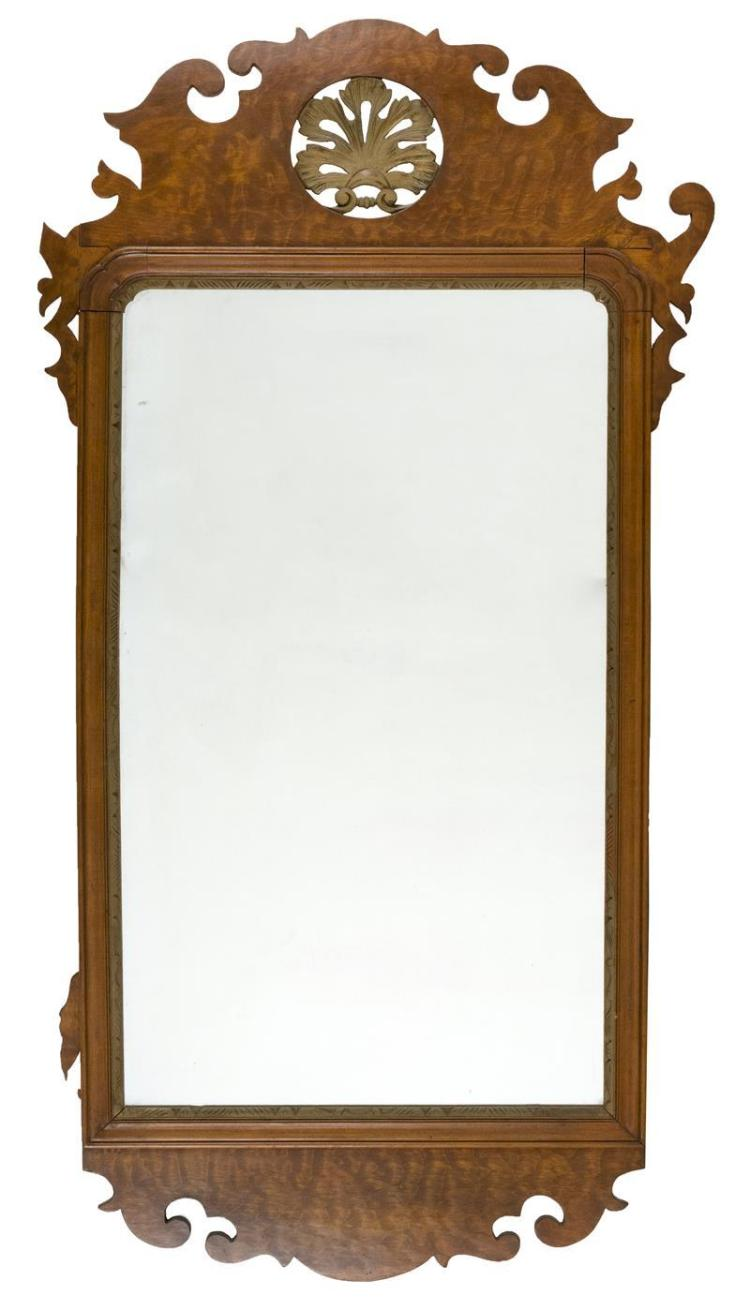 CHIPPENDALE-STYLE MIRROR Figured maple frame with scrolled top and pierced carved floral medallion. Height 42