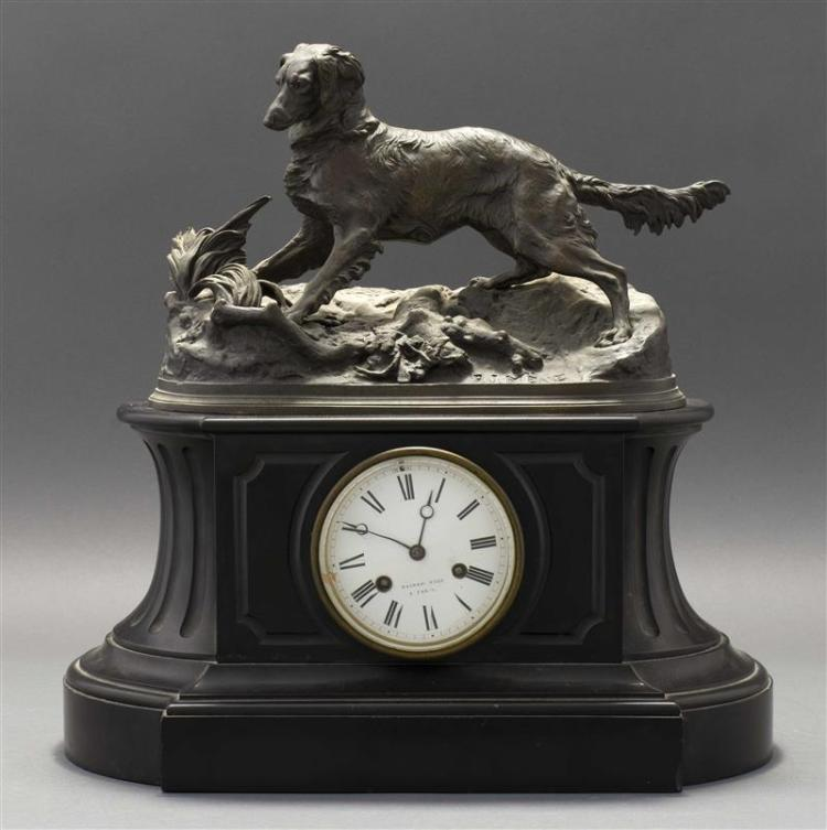 FRENCH BLACK MARBLE MANTEL CLOCK In neoclassical form. Surmounted by an unattached cast bronze sculpture of a hunting dog on a rocke...