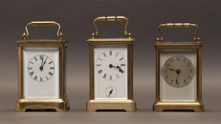 THREE FRENCH CARRIAGE CLOCKS All with brass cases with beveled glass panels. Heights approximately 4.25