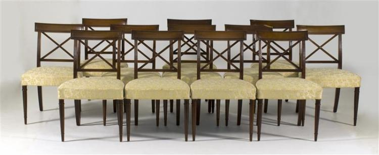 SET OF TWELVE REGENCY-STYLE SIDE CHAIRS In mahogany with rectangular crest rails, reeded crossed backs and front tapered turned legs...