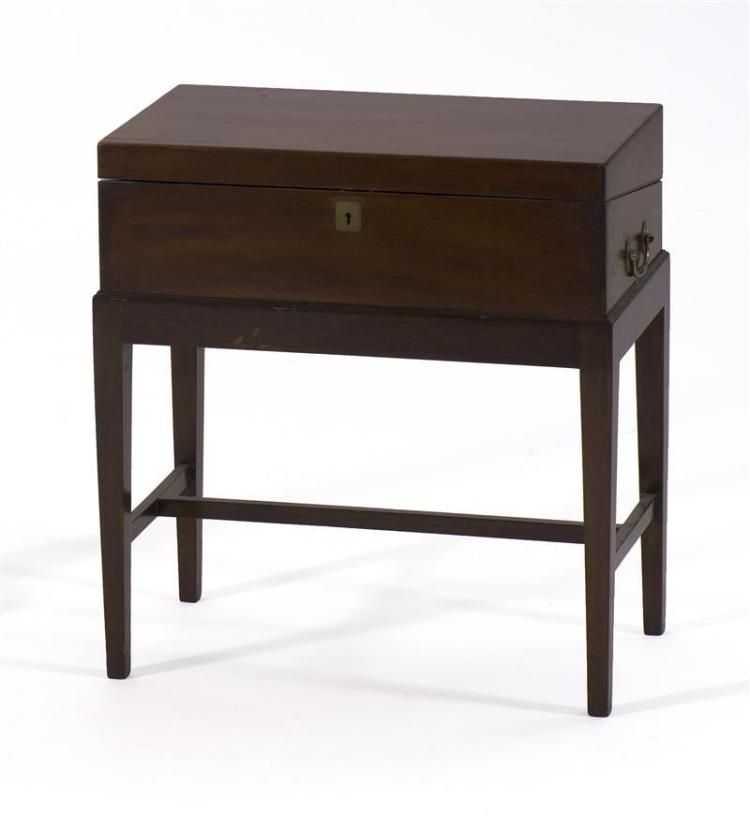 TRAVELING DESK-ON-STAND In mahogany and mahogany veneer with brass bail handles at sides. Fitted interior includes one ink bottle. H...