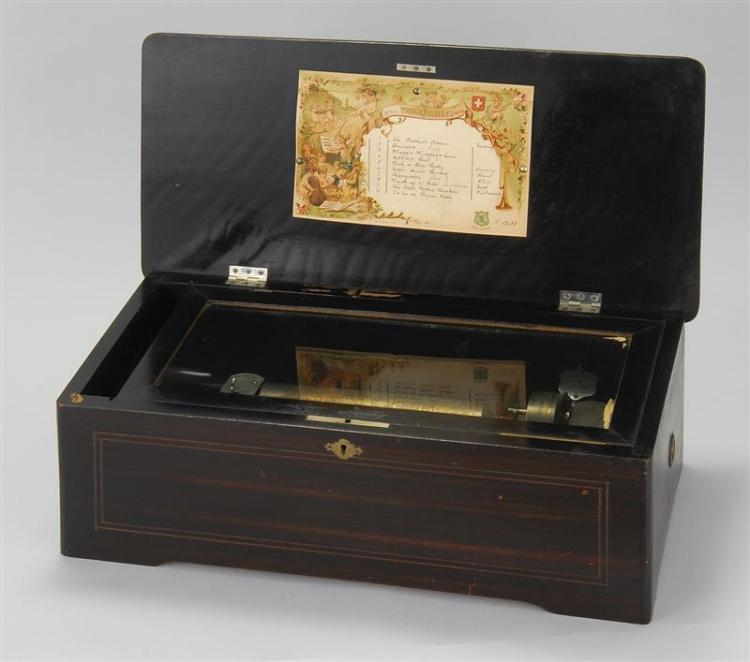 CASED SWISS MUSIC BOX Plays ten American tunes. Simulated rosewood case. Top decorated with flower basket inlay. Height 6