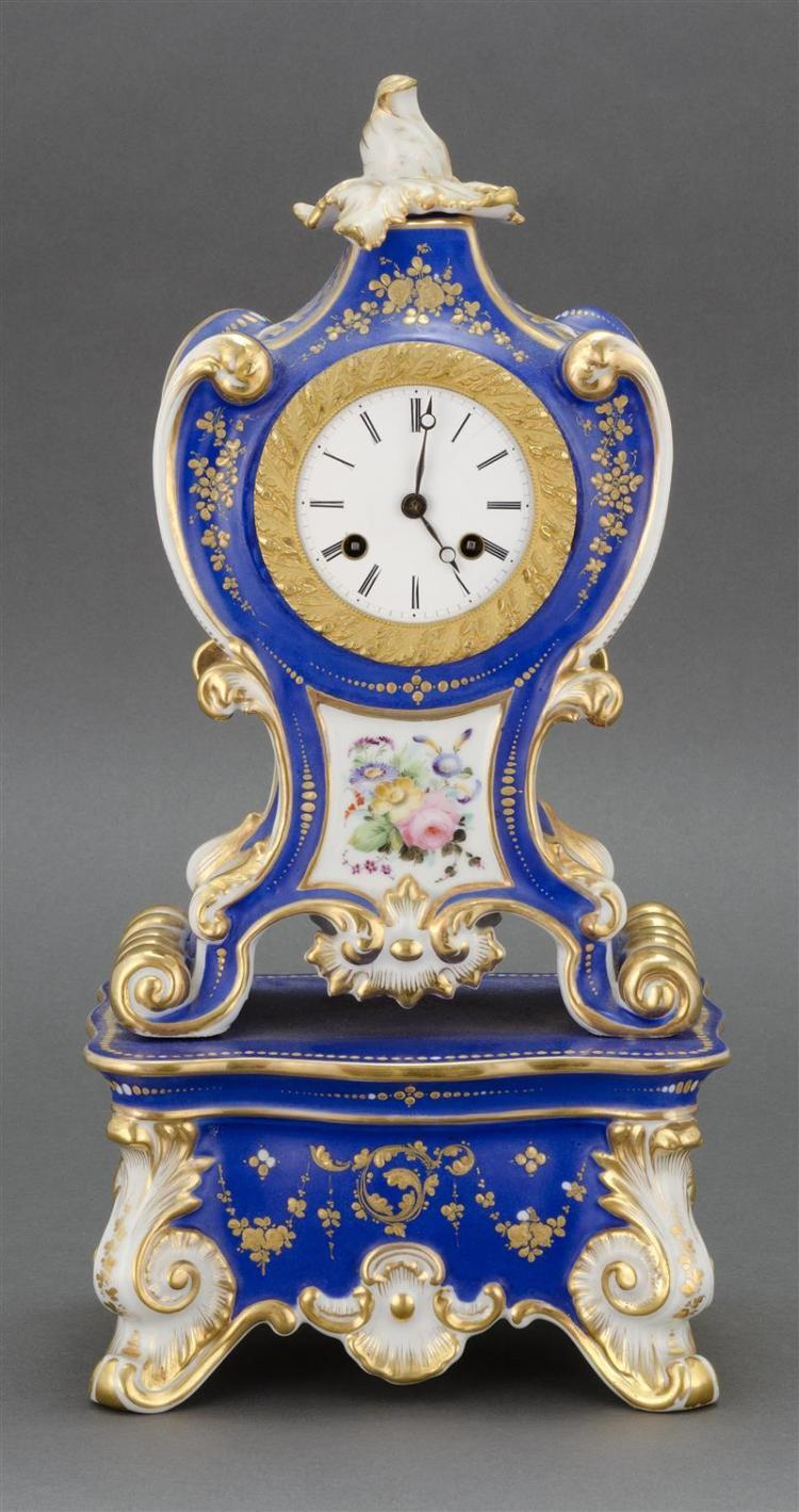 PARIS PORCELAIN SHELF CLOCK Blue and white case with gilt embellishments and removable foliate-form finial. French circular works. E...