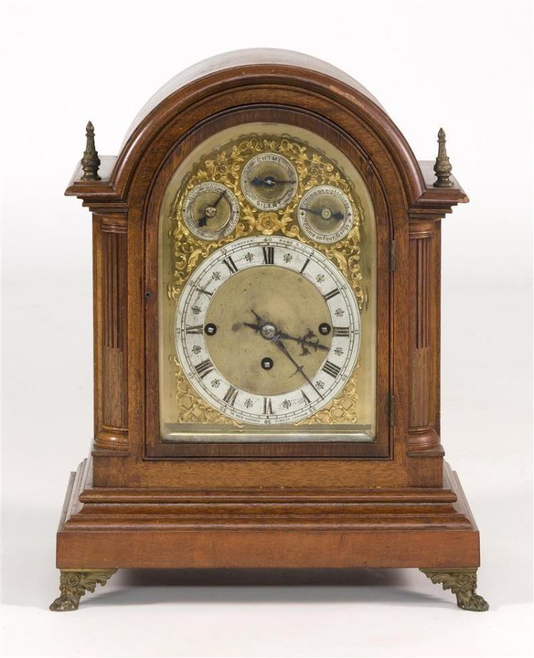 CAMERER KUSS & CO. BRACKET CLOCK Walnut case with brass finials and brass paw feet. Brass face with ormolu mounts. Steel dial with R...