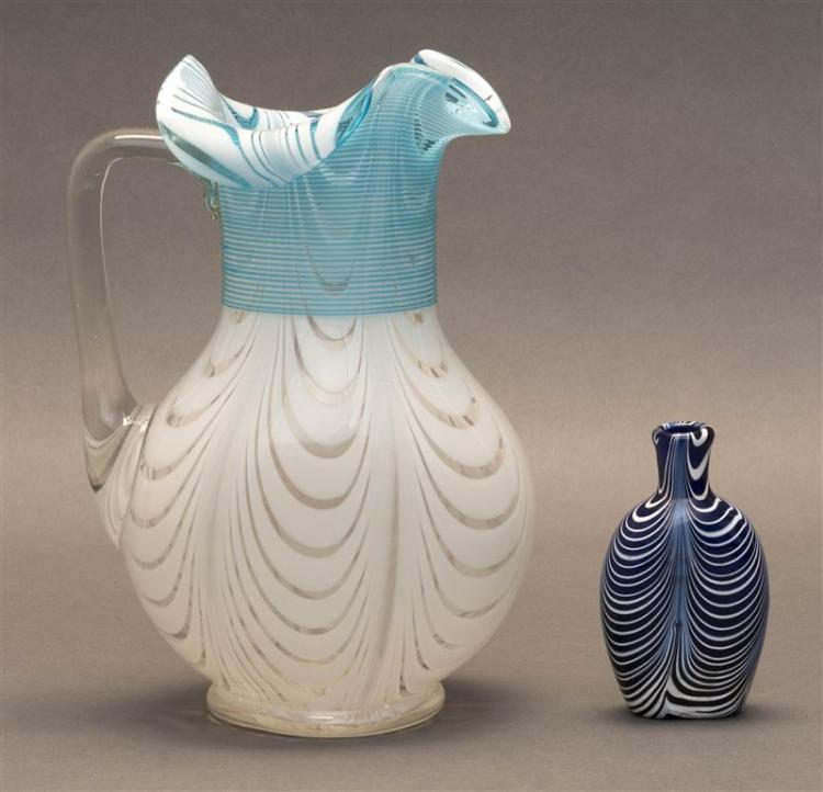 TWO PIECES OF ENGLISH THREAD GLASS Pitcher with blue threading on a clear and white peacock feather ground. Height 10.25