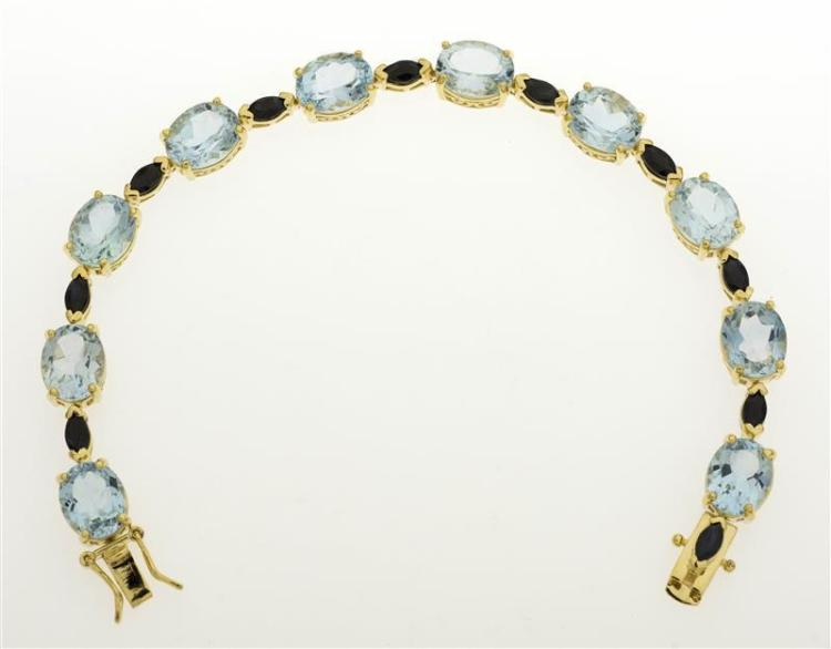 STERLING SILVER VERMEIL, TOPAZ, AND SAPPHIRE BRACELET Ten well-matched and faceted pale blue topaz stones. Each approx. 9.8 mm x 7.8...