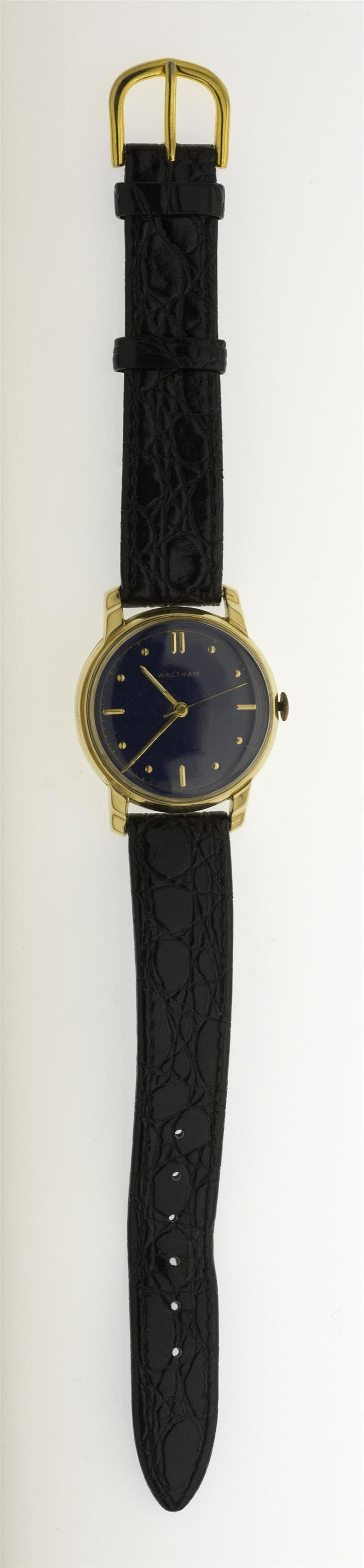 WALTHAM 14KT GOLD-FILLED MAN'S WRIST WATCH The stick dial with blue enamel. Diameter 31 mm.