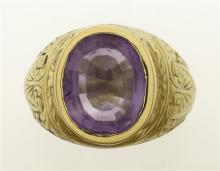 VICTORIAN 10KT GOLD AND AMETHYST MAN'S RING The bezel-set amethyst 13 mm x 10.6 mm x 7 mm. Gold with stylized palmette engraving. Un..