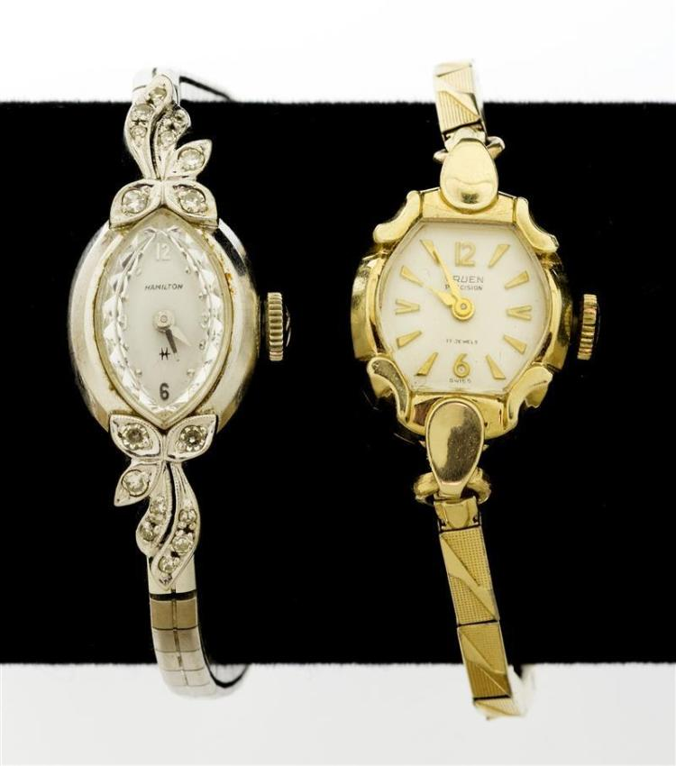 TWO VINTAGE 14KT GOLD LADY'S WRIST WATCHES One a Hamilton white gold watch set with sixteen small diamonds in a foliate motif. The o..