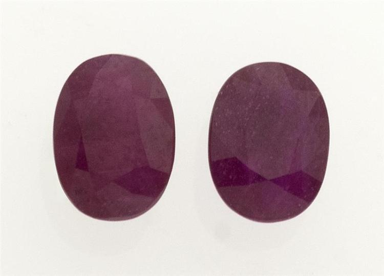 PAIR OF UNMOUNTED RUBIES Both approx. 6.6 mm x 4.8 mm. One depth 4.0 mm, the other 3.2 mm.
