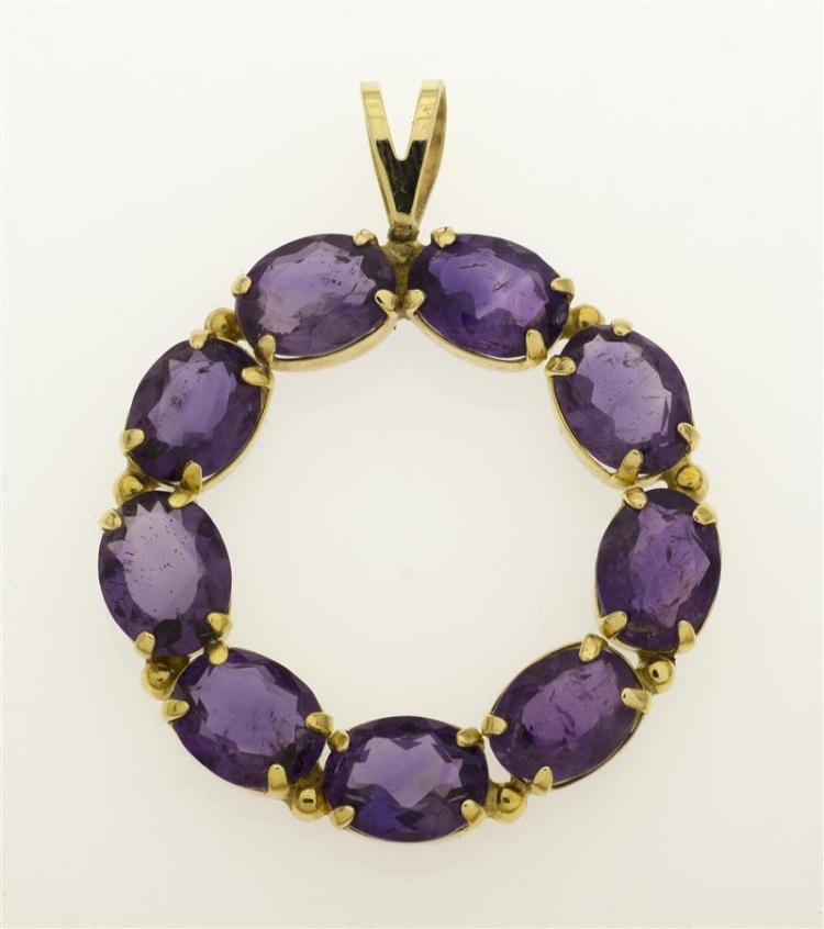 GOLD AND AMETHYST PENDANT Formed as a circle set with nine amethysts, each approx. 7.6 mm x 6.0 mm x 3.0 mm. Height 3.5 cm.