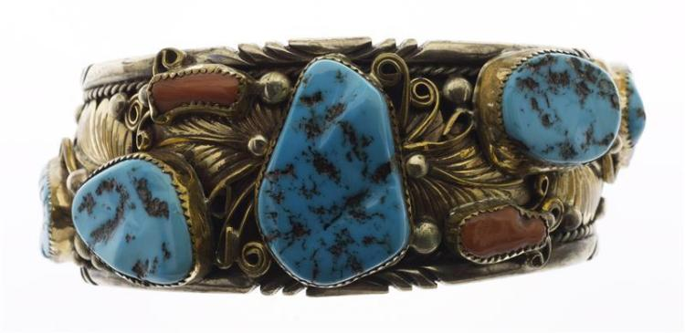 HARRY B. YAZZIE MAN'S SILVER, TURQUOISE, AND CORAL CUFF BRACELET Decorated with gilt-silver floral motif. Interior length 3