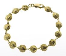 14KT GOLD LADY'S BRACELET Composed of fourteen scallop shell-form links. Length 6.75