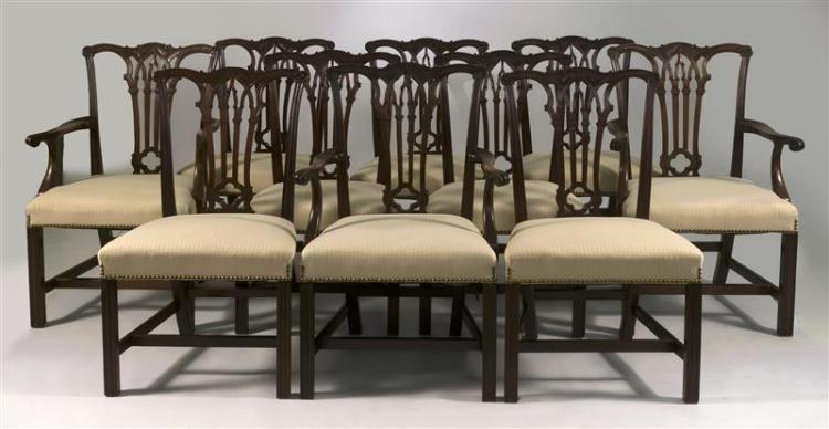 ELEVEN CHIPPENDALE-STYLE MAHOGANY DINING CHAIRS Three armchairs and eight side chairs. Each with pierced splat with quatrefoil decor...