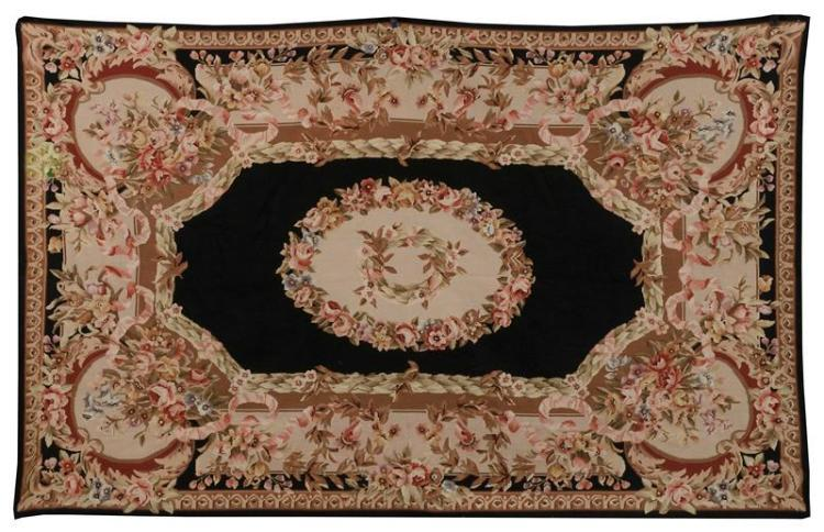 AUBUSSON TAPESTRY Decorated with architectural borders adorned with ribbands and roses. Primarily in shades of pink and café au lait...
