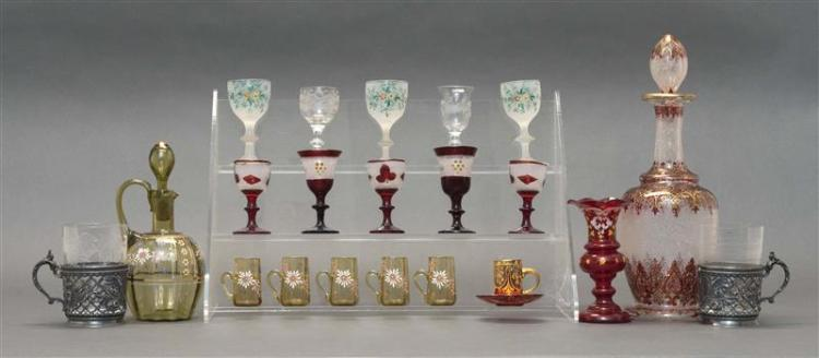 ASSORTED EUROPEAN GLASS Including a red, gold, and white decanter, a cordial cruet with five matching glasses, ten varying cordial g...