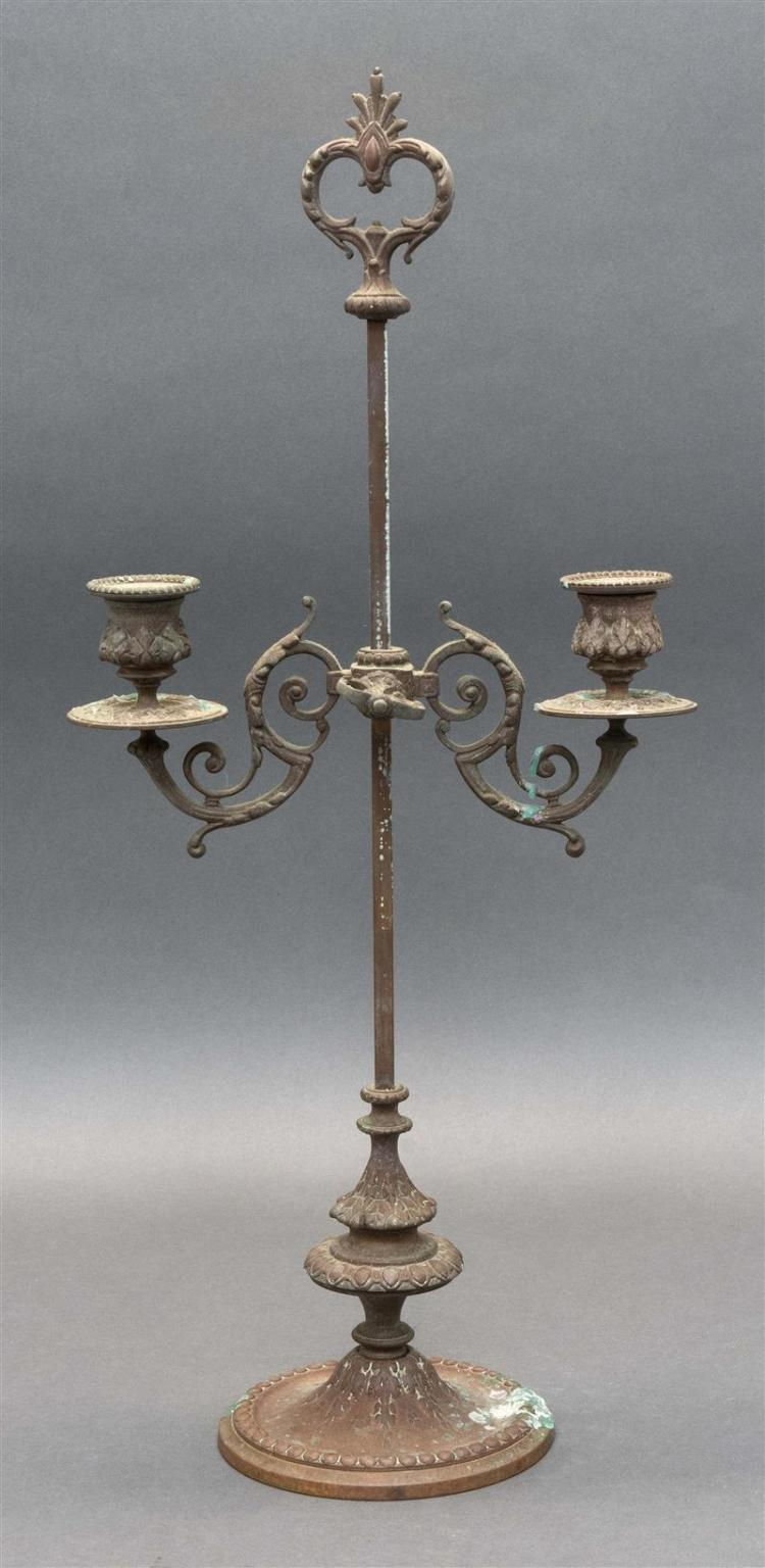 RENAISSANCE-STYLE BRONZE TWO-LIGHT CANDELABRUM Adjustable height with the two sconces supported by scrolling arms. On a circular foo...