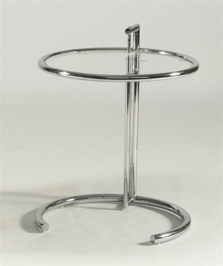 E1027-STYLE CHROME AND GLASS ADJUSTABLE SIDE TABLE AFTER EILEEN GRAY The circular top on conforming C-form base. Unmarked. Lowest he...