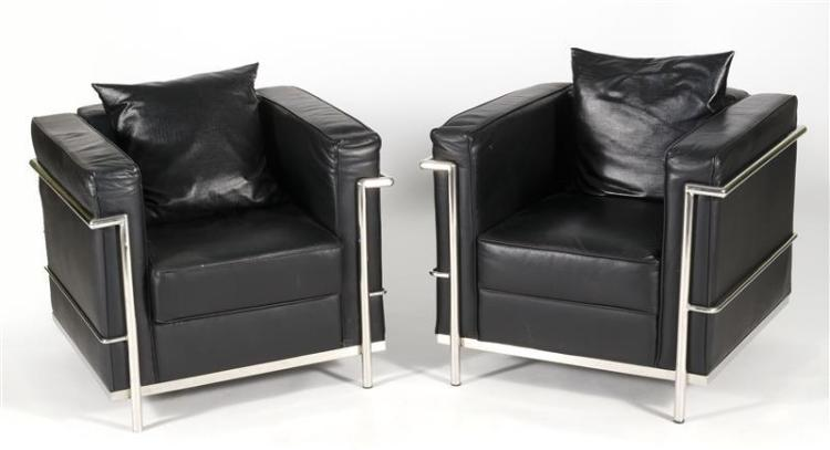 PAIR OF LC2-STYLE LEATHER AND CHROME ARMCHAIRS AFTER LE CORBUSIER With black leather upholstered cushions. Unmarked. Height 26.5