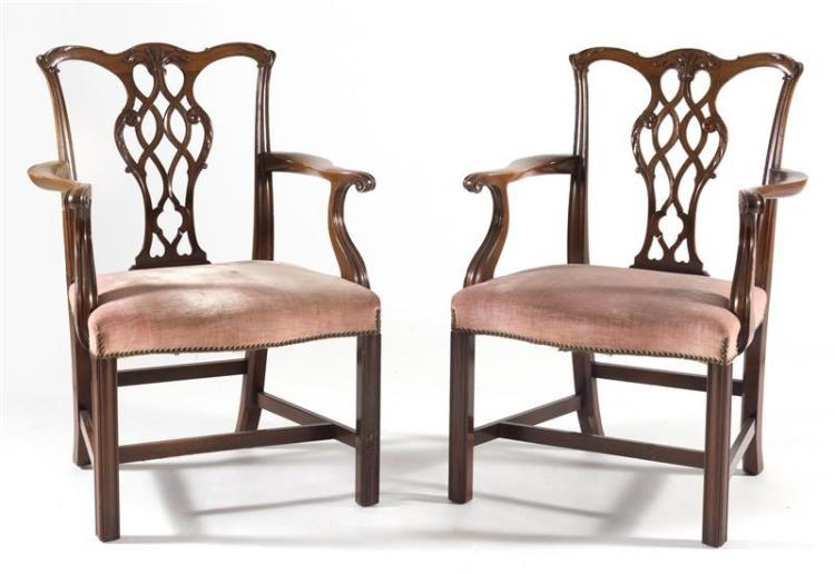 PAIR OF CHIPPENDALE-STYLE ARMCHAIRS In mahogany. With pierced backs and scrolled arms. Upholstered seats in faded pink velvet. Heigh...