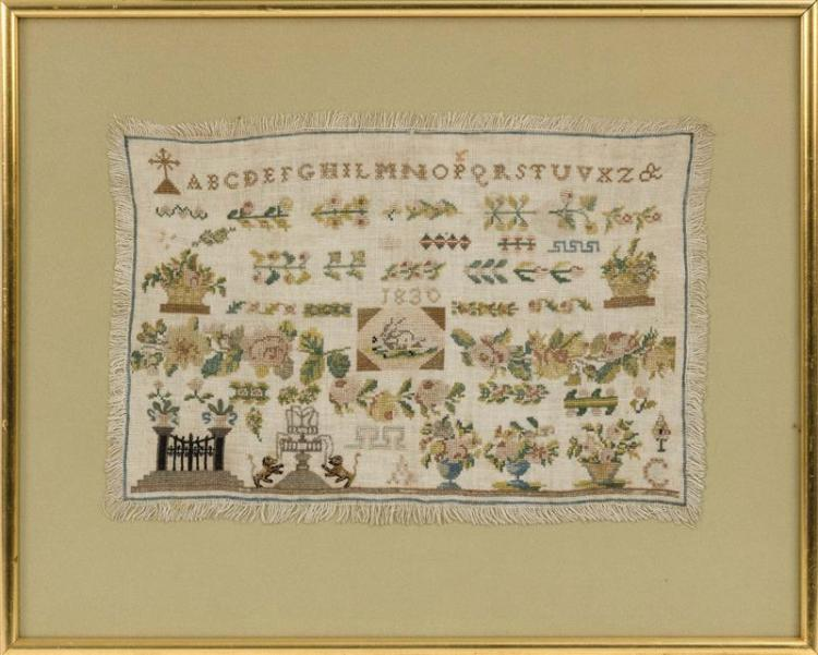 FRAMED NEEDLEWORK SAMPLER With fringed border. 9