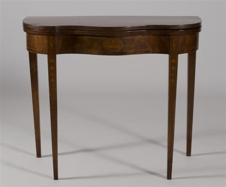 HEPPLEWHITE-STYLE CONSOLE TABLE In mahogany with serpentine front. On tapered legs with string and bellflower inlay. Oval panel inla...