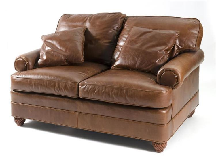 LEATHER SOFA In brown leather with wood rope-turned bun feet. Length 61