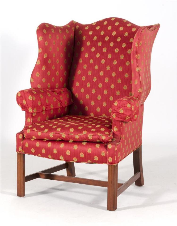 CHIPPENDALE-STYLE WING CHAIR Cranberry-colored upholstery with yellow and blue coat-of-arms print. Height of seat 16.5