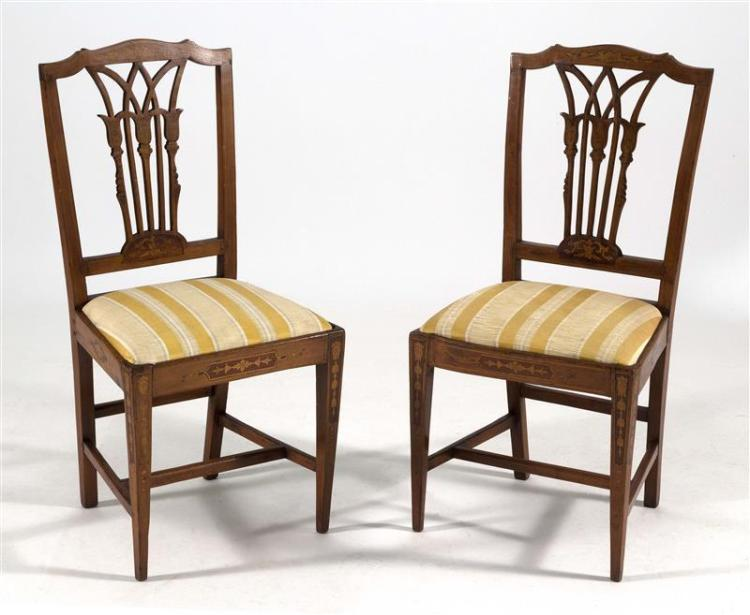 PAIR OF HEPPLEWHITE-STYLE INLAID SIDE CHAIRS With satinwood and marquetry inlay. Striped gold upholstered slip seats.