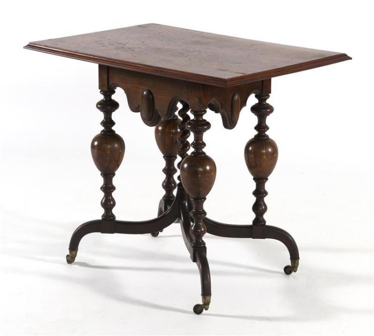 UNUSUAL BAROQUE-INFLUENCED CENTER TABLE With rectangular burl wood top with molded edge. Scalloped and carved apron. Four bulbous-tu...