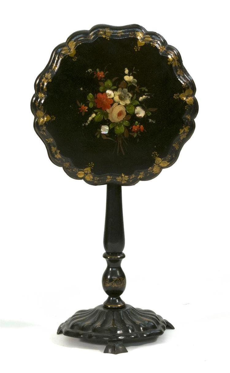 VICTORIAN PAPIER-MÂCHÉ TILT-TOP TABLE The circular top with central polychrome floral spray inlaid with mother-of-pearl and shaped a...