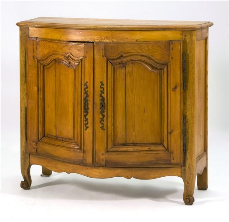 FRENCH PROVINCIAL OAK AND PINE COMMODE With bow-front top above conforming case. Fitted with two paneled doors enclosing a blue-pain...