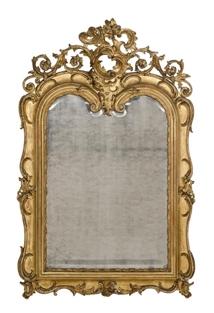 ROCOCO-STYLE GILTWOOD AND COMPOSITE PIER MIRROR The reticulated crest composed of C-scrolls and scrolling acanthus leaves. Shaped an...