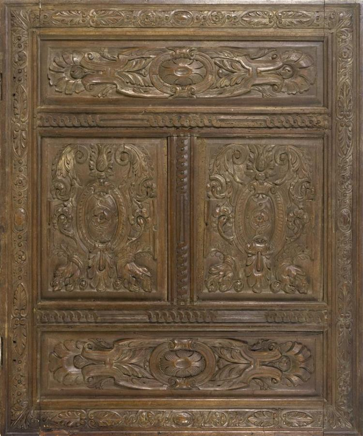 ITALIAN CARVED FRUITWOOD PANEL Rectangular and finely carved with arabesques, strapwork, and guilloche molding. Height 37.25